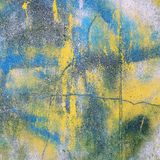 Cracked and stained concrete wall surface. Stock Image