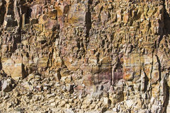 Cracked stained rock cliff formation Stock Photos