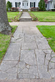 Cracked Stone Path to a Large House Royalty Free Stock Photos