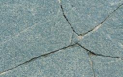Cracked stone surface. Stock Image