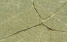 Cracked stone surface. Royalty Free Stock Photo