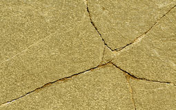 Cracked stone surface. Royalty Free Stock Photography