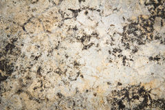 Cracked stone wall background Royalty Free Stock Images