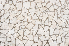 Cracked Stone Wall Background. Detail of a cracked stonewall background Stock Photos