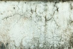 Cracked stone wall background Stock Photo