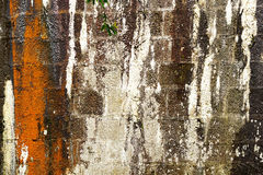 Cracked stone wall. Stock Photos