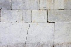 Cracked stone wall Stock Image