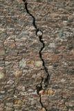 Cracked stone wall Royalty Free Stock Image