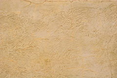 Cracked Stucco Background. A textured and cracked stucco wall Royalty Free Stock Photos