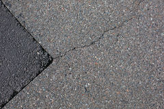 Cracked tarmac road surface Royalty Free Stock Image