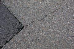 Cracked tarmac road surface Royalty Free Stock Image