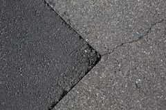 Cracked tarmac road surface Royalty Free Stock Photography