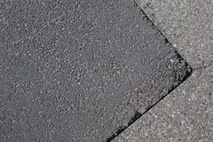 Cracked tarmac road surface Royalty Free Stock Photo