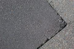 Cracked tarmac road surface Royalty Free Stock Photo
