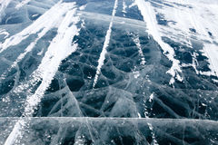 Cracked texture of ice on baikal lake in winter Royalty Free Stock Images