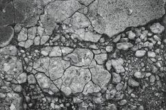 Cracked texture of small gravel stone in a concrete slab cement floor close up.  Stock Photos
