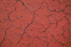 Cracked texture. There is red  cracked texture Royalty Free Stock Image