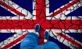 Cracked United Kingdom flag with man Stock Photography