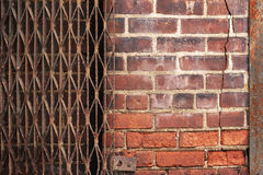 Urban Brick Backgound With Rusty Gate Royalty Free Stock Photo