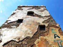 Cracked wall. Against blue sky stock photos