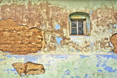 Cracked wall of an aged rural house Stock Photo