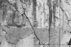 Cracked wall with bullet holes Royalty Free Stock Image