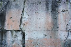 Cracked wall with bullet holes Stock Photo