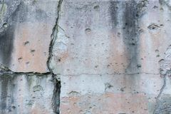 Cracked wall with bullet holes Stock Image