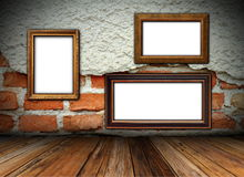 Cracked wall with frames Royalty Free Stock Photography