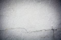 Cracked wall gray background texture. With grainy detail royalty free stock image