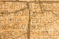 Cracked wall with Latin inscriptions and Roman letters. Royalty Free Stock Photos