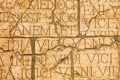 Cracked wall with Latin inscriptions and Roman letters. Stock Photo