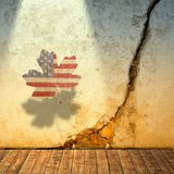 Cracked wall and maple leaf with symbolic american colors Stock Photos