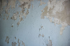 The cracked wall of the old building is blue.  Royalty Free Stock Photos