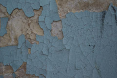 The cracked wall of the old building is blue.  Stock Photos