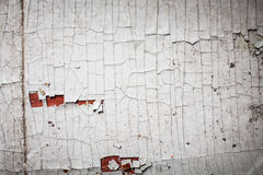 Cracked wall with old layers of paint in abandoned house Royalty Free Stock Image
