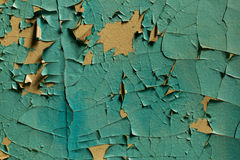 Cracked wall with old layers of paint in abandoned house Stock Photos