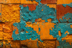Cracked wall with old layers of paint in abandoned house Royalty Free Stock Images