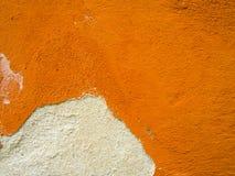 Cracked Wall. Cracked Orange Wall close up Stock Photo