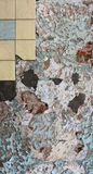 Cracked wall with peeling paint and tiles Royalty Free Stock Photography