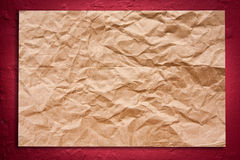 Cracked on wall on red wall. Crumpled brown paper on red wall can use if for background Royalty Free Stock Image