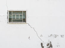 Cracked wall with a window. Cracked on wall with a window Royalty Free Stock Photography