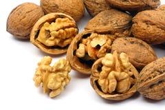 Cracked walnut cores. Isolated on white background Stock Photos