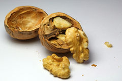 Cracked walnut with shell.(Juglans) Royalty Free Stock Photo