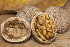 Cracked walnuts. On wooden table Royalty Free Stock Image