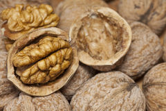 Cracked walnuts. Heap of walnuts on table Royalty Free Stock Photography