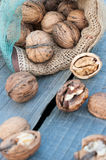 Cracked walnuts on rustic wooden table Stock Photo