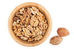 Cracked walnuts in wooden bowl Stock Photo