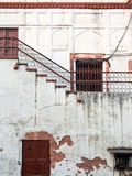 Cracked Weathered Building with Rusty Doors India Royalty Free Stock Photo