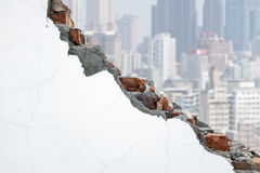 Cracked white bricks wall with crowded city building Royalty Free Stock Photography
